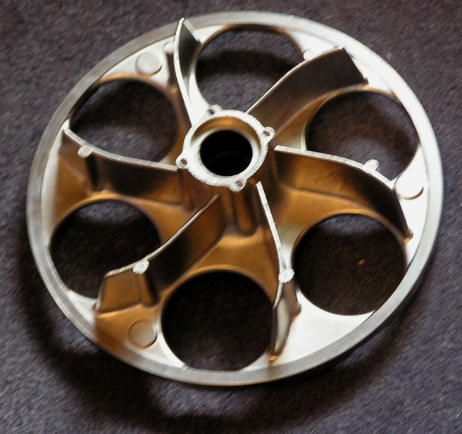 A cast aluminum wheel, perhaps a flywheel.